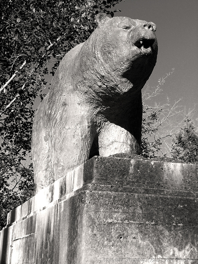The Douglas Memorial Bridge was wiped out, along with the town of Klamath, during a torrential Christmas week storm in 1964.  Townspeople waited while a massive logjam built up behind the bridge, finally breaking through the structure.  The town was rebuilt a little farther from the river.  Two of these bears are what's left of the bridge.  Klamath, California, USA