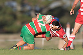 Ethan James drives Larenz Tupeae-Thomsen to ground in a strong tackle. Counties Manukau Premier 1 Club Rugby game between Karaka and Waiuku, played at the Karaka Sports Park on Saturday May 11th 2019. Karaka won the game 33 - 14 after leading 14 - 7 at halftime.<br /> Photo by Richard Spranger.