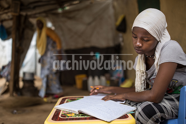A girl makes her homework in Kakuma refugee camp in Kenya.Kakuma refugee camp in North of Kenya. Kakuma is the site of a UNHCR refugee camp, established in 1991. The population of Kakuma town was 60,000 in 2014, having grown from around 8,000 in 1990. In 1991, the camp was established to host the 12,000 unaccompanied minors who had fled the war in Sudan and came walking from camps in Ethiopia.