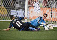 Sebastien Le Toux (11) of the Philadelphia Union tries to get a foot on the ball as Bobby Shuttlesworth (22) of the New England Revolution comes in for the save during the game at PPL Park in Chester, PA.  The Philadelphia Union defeated the New England Revolution, 1-0.