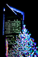 Charlotte Christmas Photography - Photography of the Carolina Panthers' decorated Christmas tree against the Charlotte skyline - Duke Energy Center building in  uptown/downtown Charlotte, North Carolina..<br /> <br /> Charlotte Photographer - PatrickSchneiderPhoto.com