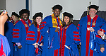 Graduates with the DePaul University College of Law pose for photos backstage before their commencement ceremony, Sunday, May 13, 2018, at the McCormick Place Grand Ballroom in Chicago, IL. Approximately 280 students received their Juris Doctors or Master of Laws degrees. (DePaul University/Jamie Moncrief)