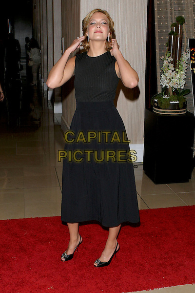 MANDY MOORE.Women In Film presents Fusion, The 2005 Crystal and Lucy Awards An Evening Celebrating Partnership held at the Beverly Hilton, Beverly Hills, CA, USA, .10th June 2005..full length black dress  funny  touching hair.Ref: ADM.www.capitalpictures.com.sales@capitalpictures.com.©Jacqui Wong/AdMedia/Capital Pictures.