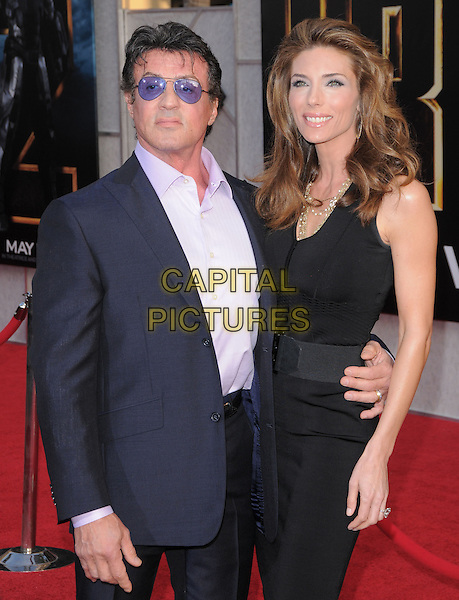 SYLVESTER STALLONE & JENNIFER FLAVIN.The Marvel World Premiere of Iron Man 2 held at The El Capitan Theatre in Hollywood, California, USA..April 26th, 2010      .half length black dress couple suit blue tinted glasses sunglasses sly aviators hand arm around waist married husband wife shades sly pink purple .CAP/RKE/DVS.©DVS/RockinExposures/Capital Pictures.