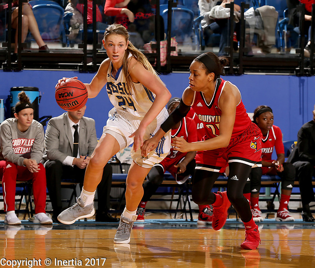 BROOKINGS, SD - DECEMBER 3: 	Tagyn Larson #24 from South Dakota State takes the ball to the basket against Asia Durr #25 from Louisville during their game Sunday afternoon at Frost Arena in Brookings, SD.  (Photo by Dave Eggen/Inertia)