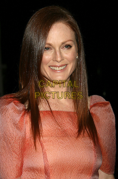 JULIANNE MOORE.13th Annual Hollywood Awards presented by the Hollywood Film Festival held at the Beverly Hilton, Beverly Hills, CA, USA..October 26th, 2009.headshot portrait red coral orange peach puff shoulders shoulder pads d.CAP/ADM/MJ.©Michael Jade/AdMedia/Capital Pictures.