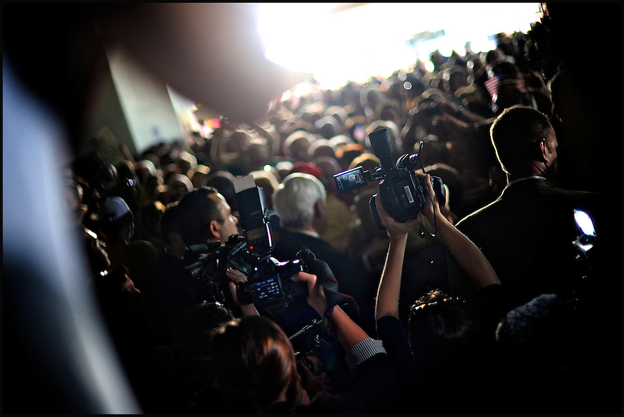 Surrounded by media and supporters, former House speaker and Republican presidential candidate Newt Gingrich (C) makes his way back to his bus following a campaign stop in Sarasota, Florida, USA, 24 January 2012. Republican candidates will campaign in Florida in the lead up to the Florida Primary on 31 January 2012.