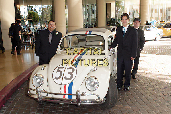 MARIO LARRAZA & PETER PASCO WITH HERBIE THE LOVE BUG.20th Annual Imagen Awards Gala Presented by the Imagen Foundation held at the Beverly Hilton Hotel, Beverly Hills, California.June 17th, 2005.Photo Credit: Zach Lipp/AdMedia.full length car 53 black suit.www.capitalpictures.com.sales@capitalpictures.com.© Capital Pictures.