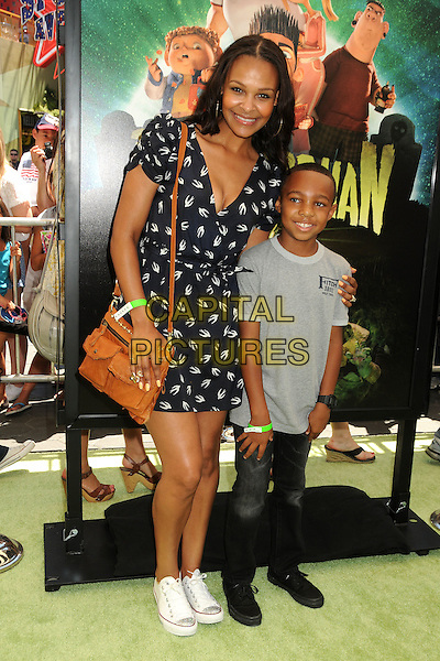 "Samantha Mumba & guest.""ParaNorman"" Los Angeles Premiere held at AMC CityWalk Stadium 19 Theatre, Universal City, California, USA..August 5th, 2012.full length white black print dress brown satchel grey gray top jeans denim sneakers trainers  birds swallows .CAP/ADM/BP.©Byron Purvis/AdMedia/Capital Pictures."