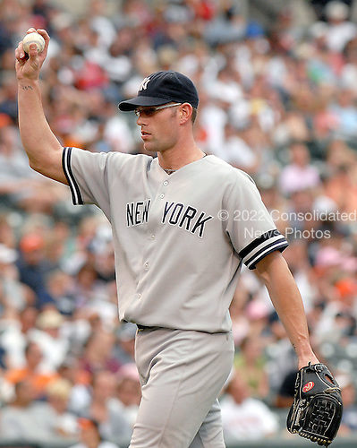 Baltimore, MD - July 29, 2007 -- New York Yankee pitcher Kyle Farnsworth (48) asks for a new ball during his relief appearance in the 8th inning against the Baltimore Orioles at Oriole Park at Camden Yards in Baltimore, MD on Sunday, July 29, 2007.  Farnsworth pitched a full inning giving up 2 runs on 2 hits.  The final score was Yankees 10 - Orioles 6..Credit: Ron Sachs / CNP.(RESTRICTION: No New York Metro or other Newspapers within a 75 mile radius of New York City)