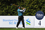 JEJU, SOUTH KOREA - APRIL 23:  Thongchai Jaidee of Thailand tees off on the 4th hole during the Round Two of the Ballantine's Championship at Pinx Golf Club on April 23, 2010 in Jeju island, South Korea. Photo by Victor Fraile / The Power of Sport Images
