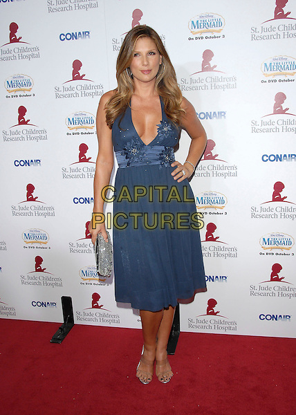 DAISY FUENTES.Attends Runway for Life, Benefiting St. Jude Children's Research Hospital held at The Beverly Hilton Hotel in Beverly Hills, California, USA, September 15th 2006..full length blue dress hand on hip.Ref: DVS.www.capitalpictures.com.sales@capitalpictures.com.©Debbie VanStory/Capital Pictures