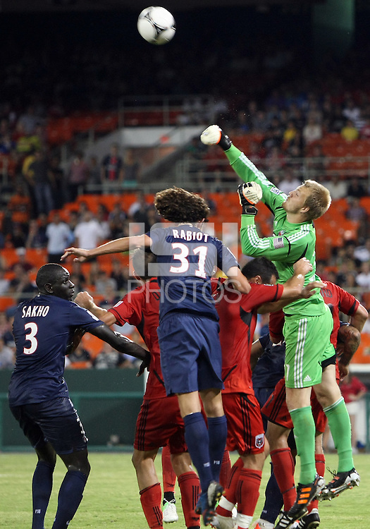 WASHINGTON, DC - July 28, 2012:  Joe Willis (31) of DC United punches away from Adrien Rabiot (31) of PSG (Paris Saint-Germain) in an international friendly match at RFK Stadium in Washington DC on July 28. The game ended in a 1-1 tie.