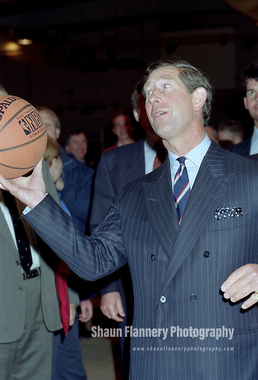 Pix: Shaun Flannery/shaunflanneryphotography.com...COPYRIGHT PICTURE>>SHAUN FLANNERY>01302-570814>>07778315553>>..8th June 1995..HRH Prince Charles prepares to take a shot at a basketball hoop during a visit to the Doncaster Panthers basketball club.