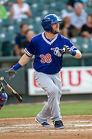 Oklahoma City Dodgers designated hitter Andy Wilkins (38) follows through on his swing during the Pacific Coast League baseball game against the Round Rock Express on June 9, 2015 at the Dell Diamond in Round Rock, Texas. The Dodgers defeated the Express 6-3. (Andrew Woolley/Four Seam Images)