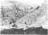 The Pandora box canyon structures.  The Old Sheridan and Medota Mill is at left center in the background.  The remaining buildings are part of the Smuggler-Union Mill complex.<br /> RGS  Pandora, CO