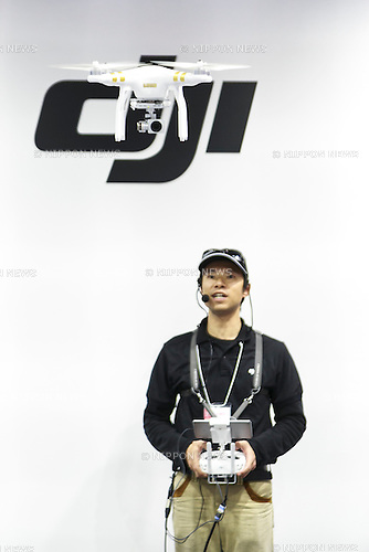 An exhibitor flies a drone DJI Phantom 3 at the CP+ 2016 Camera & Imaging Show on February 25, 2016, in Yokohama, Japan. CP+ is the biggest camera and photo imaging showcase in Japan with 132 exhibitors across  1,073 booths in Osanbashi Hall and Pacifico Yokohama, and organizers expect 70,000 visitors over the course of the exhibition that runs until Sunday 28th. (Photo by Rodrigo Reyes Marin/AFLO)