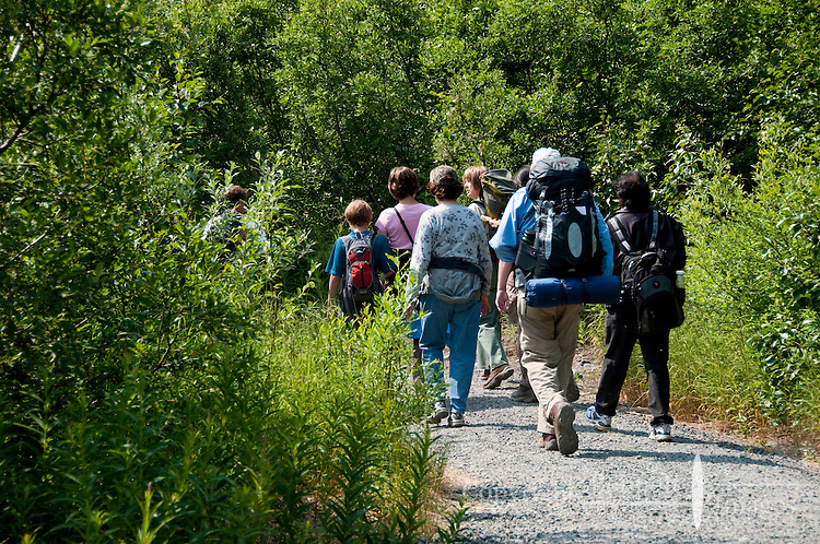 A Forest Service Interpreter leads a group of campers and day tourists up the trail to Spencer Lake.