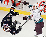 Mighty Ducks of Anaheim Vitaly Vishnevski hits Edmonton Oilers' Ales Hemsky during the first period of NHL play at Edmonton's Rexall Place, on Monday February 6, 2006. (John Ulan)