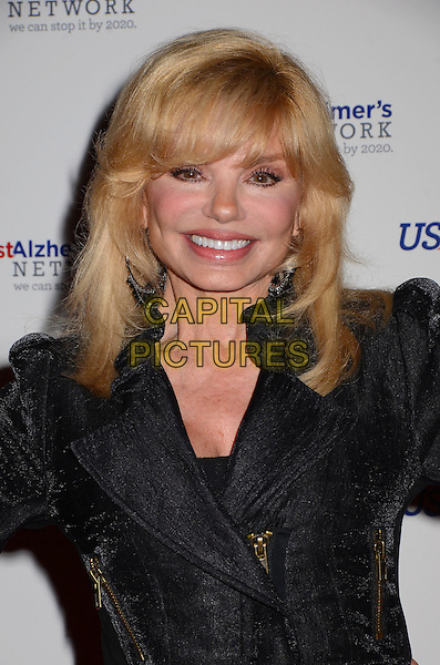Loni Anderson<br /> Los Angeles premiere of &quot;Surviving Grace&quot; at the Stephen J. Ross Theater on the Warner Bros. Studios lot in Burbank, California, USA.<br /> September 25th, 2013<br /> headshot portrait black jacket<br /> CAP/ADM/BT<br /> &copy;Birdie Thompson/AdMedia/Capital Pictures