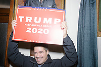 Trump supporters are seen in the hallways outside the NH Secretary of State's office in the New Hampshire State House in Concord, New Hampshire, on Thu., November 7, 2019. The crowd was there as Vice President Mike Pence traveled to New Hampshire as a surrogate for Donald Trump to file required paperwork for the president to get on the New Hampshire presidential primary ballot in 2020. The required documents include a filing form signed by the candidate and a $1000 filing fee.