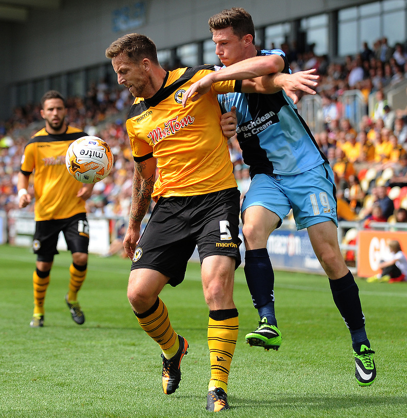 Newport County's Darren Jones battles with Wycombe Wanderers' Matt McClure<br /> <br /> Photographer Ian Cook/CameraSport<br /> <br /> Football - Newport County v Wycombe Wanderers - Sky Bet League 2 - Saturday 09th August 2014 - Rodney Parade - Newport<br /> <br /> &copy; CameraSport - 43 Linden Ave. Countesthorpe. Leicester. England. LE8 5PG - Tel: +44 (0) 116 277 4147 - admin@camerasport.com - www.camerasport.com