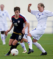 USWNT midfielder (15) Megan Rapinoe sprints past Iceland's (7) Dora Stefansdottir during the Algarve Cup.  The USWNT defeated Iceland, 1-0, at Ferreiras, Portugal.