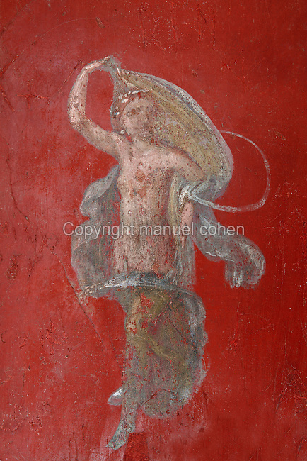 Detail of a dancing woman on a red background, fresco in the Fourth Style of Roman wall painting, 60-79 AD, in the large room adjoining the service room in the Fullonica di Stefanus, or Fullonica of Stephanus, a laundry in Pompeii, Italy. Pompeii is a Roman town which was destroyed and buried under 4-6 m of volcanic ash in the eruption of Mount Vesuvius in 79 AD. Buildings and artefacts were preserved in the ash and have been excavated and restored. Pompeii is listed as a UNESCO World Heritage Site. Picture by Manuel Cohen