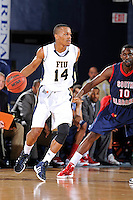 25 February 2012:  FIU guard DeJuan Wright (14) handles the ball while being defended by South Alabama guard Wendell Wright (10) in the first half as the FIU Golden Panthers defeated the University of South Alabama Jaguars, 81-74, at the U.S. Century Bank Arena in Miami, Florida.