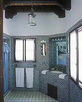 An ensuite bathroom clad with traditional blue and white patterned wall tiles
