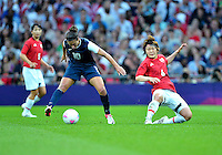 August 09, 2012: United States' Carli Lloyd and Japan's Mizuho Sakaguchi in action during Football Final match at the Wembley Stadium on day thirteen in Wembley, England. USA defeat Japan 2-1 to win it's third consecutive Olympic gold medal in women's soccer. ..
