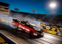 Jun 1, 2018; Joliet, IL, USA; NHRA funny car driver Cruz Pedregon (near) does a burnout alongside Ron Capps during qualifying for the Route 66 Nationals at Route 66 Raceway. Mandatory Credit: Mark J. Rebilas-USA TODAY Sports