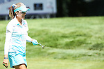 Lexi Thompson smiles on the 11th fairway at the LPGA Championship 2014 Sponsored By Wegmans at Monroe Golf Club in Pittsford, New York on August 13, 2014