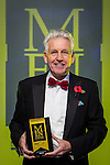 © Joel Goodman - 07973 332324 . 06/11/2014 .  Manchester , UK . TV Presenter NICK OWEN holds up one of the awards . The MEN Business Awards 2014 at the Midland Hotel . Photo credit : Joel Goodman
