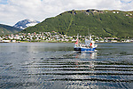 Fishing boat leaving port at Tromso, Norway