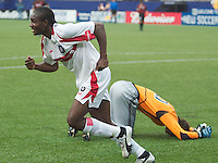 Chicago's Damani Ralph celebrates scoring a goal as MetroStars' goal keeper Paul Grafer lays on the ground. The Chicago Fire defeated the NY/NJ MetroStars 3-2 on 6/14/03 at Giant's Stadium, NJ..