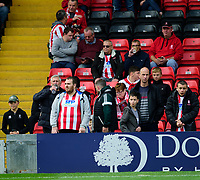 Lincoln City fans enjoy the pre-match atmosphere<br /> <br /> Photographer Andrew Vaughan/CameraSport<br /> <br /> The EFL Sky Bet League One - Lincoln City v Sunderland - Saturday 5th October 2019 - Sincil Bank - Lincoln<br /> <br /> World Copyright © 2019 CameraSport. All rights reserved. 43 Linden Ave. Countesthorpe. Leicester. England. LE8 5PG - Tel: +44 (0) 116 277 4147 - admin@camerasport.com - www.camerasport.com