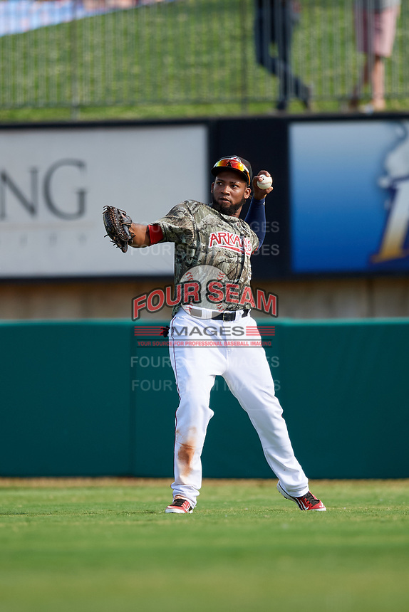 Arkansas Travelers right fielder Keury De La Cruz (34) throws from the outfield during a game against the Frisco RoughRiders on May 28, 2017 at Dickey-Stephens Park in Little Rock, Arkansas.  Arkansas defeated Frisco 17-3.  (Mike Janes/Four Seam Images)