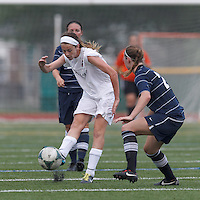 Boston Aztec defender Kerri Zerfoss (28) passes the ball.  In a Women's Premier Soccer League (WPSL) match, Boston Aztec (white) defeated Seacoast United Phantoms (blue), 3-0, at North Reading High School Stadium on Arthur J. Kenney Athletic Field on on June 25, 2013.
