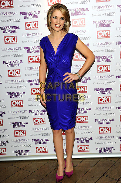 Charlotte Hawkins.Leo Bancroft range - launch party.celebrity hairstylist launches his latest brand of products at exclusive West End members club, The Club at The Ivy, London, England..April 18th, 2012.full length dress hand on hip purple blue sleeveless pink shoes .CAP/CJ.©Chris Joseph/Capital Pictures.