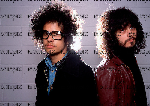 The Mars Volta - guitarist Omar Rodriguez-Lopez (in glasses) and vocalist Cedric Bixler-Zavala - photographed exclusively at Manchester University, Manchester, UK - 26 Mar 2003.  Photo by: Tony Woolliscroft/IconicPix