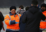 A steward wearing gloves searches a fan ahead of the Premier League match at the Emirates Stadium, London. Picture date: 7th March 2020. Picture credit should read: Paul Terry/Sportimage