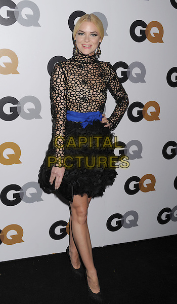 Jaime King.Arriving at the GQ Men Of The Year Party at Chateau Marmont Hotel in Los Angeles, California, USA..November 13th, 2012.full length black lace netting long sleeves top high collar skirt blue sash waist belt hand on hip ruffles clutch bag.CAP/ROT/TM.©Tony Michaels/Roth Stock/Capital Pictures