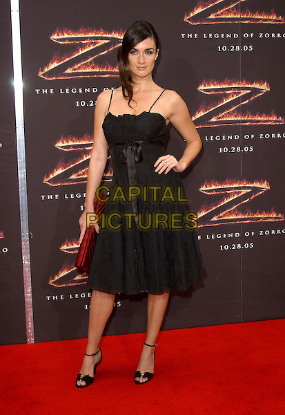 "PAZ VEGA.Los Angeles Premiere of ""The Legend of Zorro"" held at The Orpheum Theatre in Downtown Los Angeles, California. October 16th, 2005.full length black dress hand on hip.www.capitalpictures.com.sales@capitalpictures.com.Supplied By Capital PIctures"