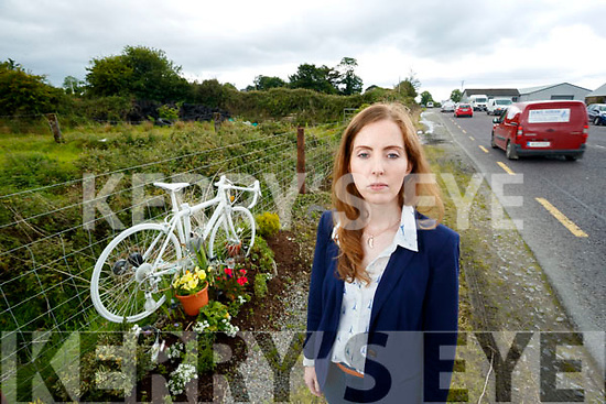 Siobhan Dwyer with a Ghost Bicycle, memorial near Farranfore, dedicated to the memory of her late partner Killarney Cyclist Ed Duggan who was killed in 2015 on the road.