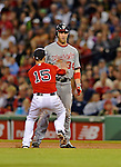 8 June 2012: Washington Nationals outfielder Bryce Harper is caught in a rundown by Dustin Pedroia in the 6th inning against the Boston Red Sox at Fenway Park in Boston, MA. The Nationals defeated the Red Sox 7-4 in the opening game of their 3-game series. Mandatory Credit: Ed Wolfstein Photo