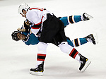 New Jersey Devils center Adam Mair knocks down San Jose Sharks center Jamal Mayers during a fight in the first period of an NHL hockey game in San Jose, Calif., Wednesday, Oct. 27, 2010. (AP Photo/Paul Sakuma)