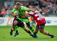Northampton Saints' Stephen Myler is tackled by Gloucester Rugby's Gareth Denman <br /> <br /> Photographer Ashley Western/CameraSport<br /> <br /> Aviva Premiership - Gloucester v Northampton Saints - Saturday 7th October 2017 - Kingsholm Stadium - Gloucester<br /> <br /> World Copyright &copy; 2017 CameraSport. All rights reserved. 43 Linden Ave. Countesthorpe. Leicester. England. LE8 5PG - Tel: +44 (0) 116 277 4147 - admin@camerasport.com - www.camerasport.com