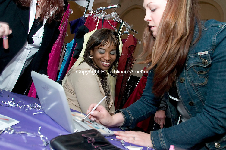 WATERBURY, CT- 15 APRIL 07- 041507JT12- <br /> Idona Keys, 17, gets a make-over from Shauna Bowers from Mary Kay at the Waterbury Youth Services' fourth annual Perfect Prom Project on Sunday at the agency. Gowns for the event were donated by Joyce's Bridal &amp; Formal Wear, Delianne Bridal &amp; Formal Wear, Great White Way, Ragtime Boutique, and Wedding Embassy among other private donors. Also featured was jewelry donated by Heather Jones, and flower arrangements donated by O'Rourke and Birch Florist.<br /> Josalee Thrift Republican-American