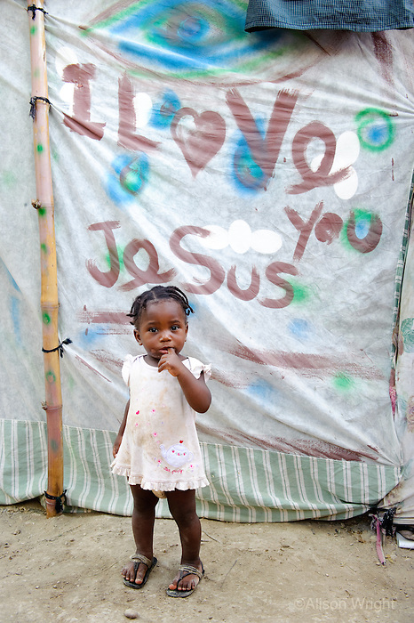 "Devastation after the earthquake. Displaced people, little girls in front of tent that says ""I Love Jesus,"" living in tent city on church property of Venerable St. Jean de la Mennais. 2/4/10"